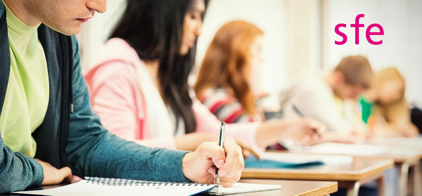 Man writing in classroom